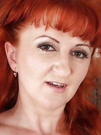 Red headed MILF Trixi from AllOver30 shows off her..