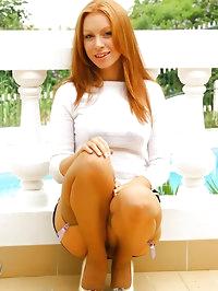 Gorgeous redhead Alex the secretary with beige stockings