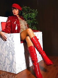 Horny leggy Milf Lily in stockings and red boots