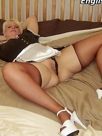 English maid clad in copper seamed stockings gets dirty on..