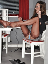 Nylon Jane is dressed in gorgeous stockings and is..