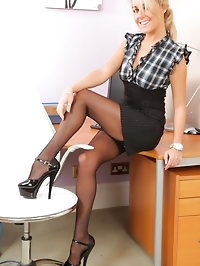 Sexy blonde in a tight black top, pinstripe pencil skirt..