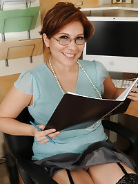 Office gal Veronica Devil takes a break from work to..