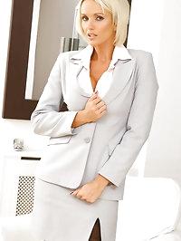 Delightful blonde secretary Lucy Zara gets comfortable as..