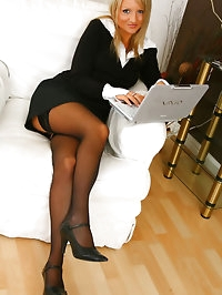 Blonde beauty Liana Lace relaxes on her sofa in nothing..