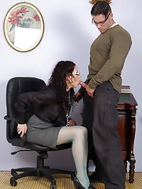 cock sucking slut in stockings getting cum on her glasses