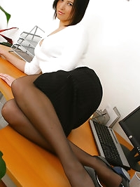 Office girl Carole loves the attention as she slips out of..