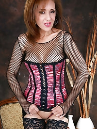 Cute brunette MILF wearing hot and sexy fishnet