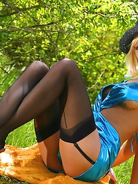 Leggy beauty in black stockings outdoor