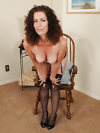 Sexy mature Tammy Sue from AllOver30 sits in a chair and..