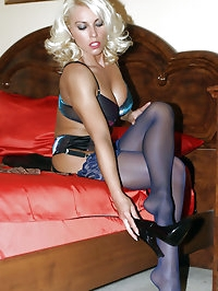 Seducing my cleaner in my bedroom and putting my nylons..