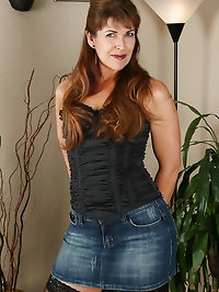 Andie shows off her denim skirt before showing off her..