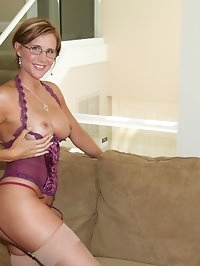 Sexy Busty Housewife In Erotic Lingerie with Stockings and..