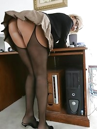 Blonde Sexy Wife at Home in her Office wearing Stockings
