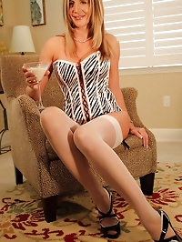Hot wife Desirae showing her silky stockings and lingerie