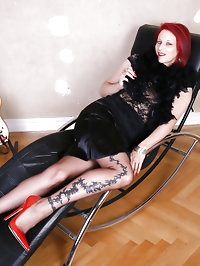 Redhead show her hot red high heels and soles