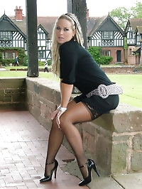 Melanie is outdoors showing off her nylon covered legs and..