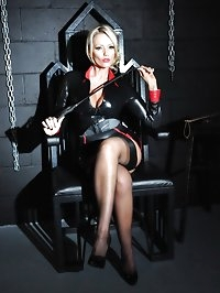 Horny Mistress Lucy Zara strips off in dungeon whilst..
