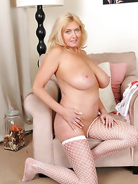 Mature and busty Tahnee Taylor breaks from her hard..