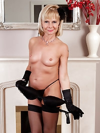 Blonde 42 year old Cath Oakley slips off her black..