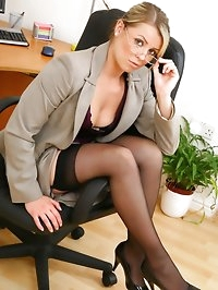Stunning blonde secretary takes off her clothes and shows..
