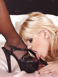 Dominatrix enjoys her foot slave