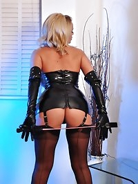 Lucy Zara is dressed in full bondage gear and showing off..