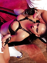 Babe in leather fucking on the fetish chair