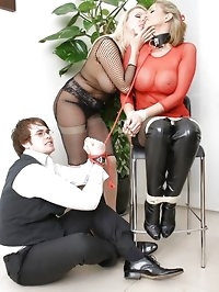 Stunning lezdom in fishnet suit ties up and taunts naughty..
