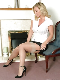 A very sexy blonde relaxing at home in her heels and nylons