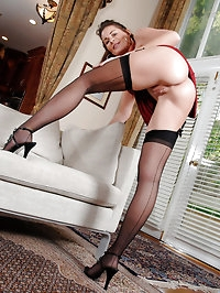 Anilos cougar strips off her dress and satisfies her pussy..