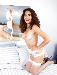 Hairy bushed Isabelle from AllOver30 probes her hot pussy..