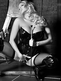 Stunning blonde in pvc leather licking her long black cane