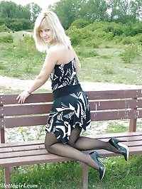 This gorgeous blonde has some lacy stockings under her..