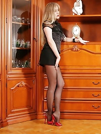 Corset and black miniskirt over pantyhose