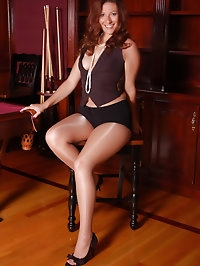 Gorgeous beauty with nude pantyhose and heels