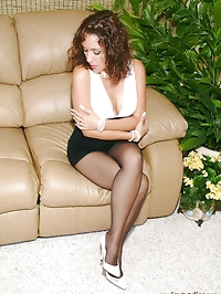 Pure mature model showing her ass in pantyhose