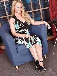 Blonde looks stunning in nylons and black bra