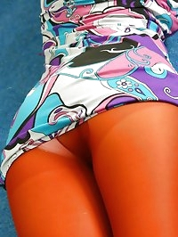 Busty blonde in a delightful purple sixties outfit with..