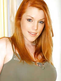 Fiery redhead Fi strips out of her sexy tight top and..