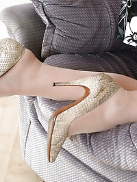 These snake skin high heels look really naughty on this babe