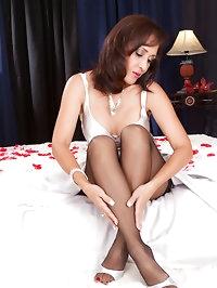 Beautiful MILF in black sexy stockings