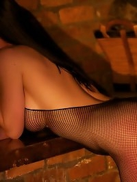 Miss Hybrid Fireside toy fun in a crothless fishnet..