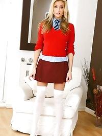 Natasha in red college miniskirt and white over knee socks.