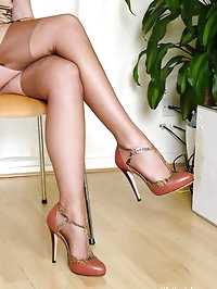 Silver high heels compliment this blonde babes long legs..