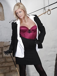 Sexy blonde femdom Victoria holding her cane in sexy..
