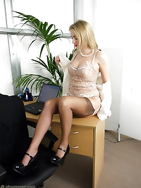 Blonde secretary in seamed stockings shows her secrets in..