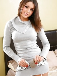 Stunning Bryoni-Kate relaxes on her bed in a sexy tight..